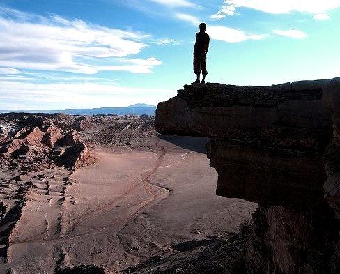 by jgomba on Flickr.Admiring the view in Valle de la Luna - San Pedro de Atacama, Chile.