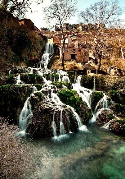 Waterfall in the medieval village of Orbaneja del Castillo, Burgos, Spain